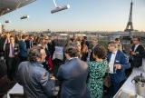 Outdoor cocktail reception with brokers in Paris