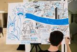 Artist drawing a blue toned cartoon version of the Liberty Specialty Markets timeline
