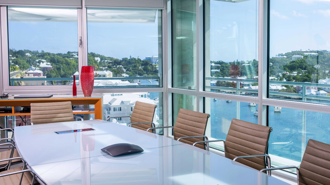 Windows overlooking Bermuda landscape from an empty conference room in the Liberty Specialty Markets office