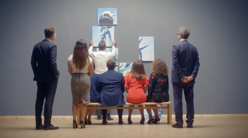 People gazing at painting