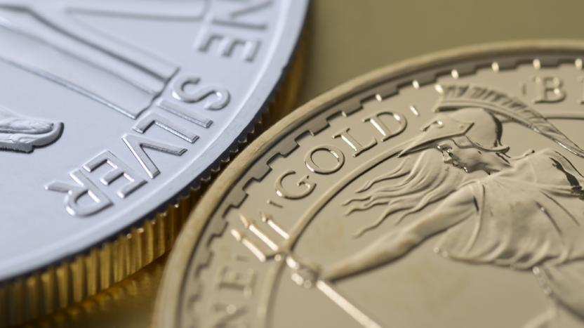 close up of silver and gold coin