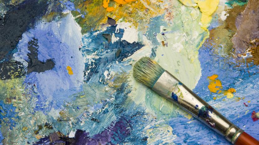 blue and gold paint with paintbrush