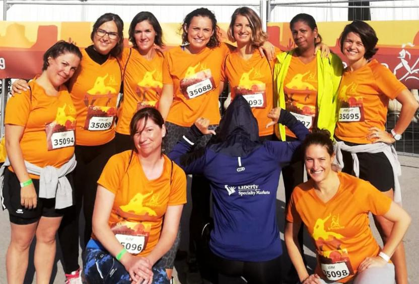 Group photo of female Liberty Specialty Markets employees participating in the Paris Women's marathon