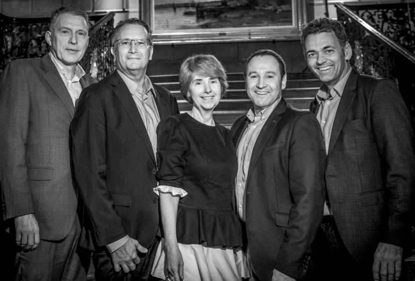 Posed black and white photo of part of the Liberty Specialty Markets Central leadership team