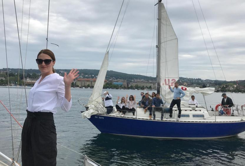 Switzerland Liberty Specialty Markets team relaxing on sailboats during Zurich Team Day