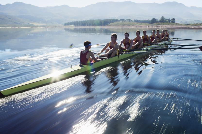 Team of people rowing